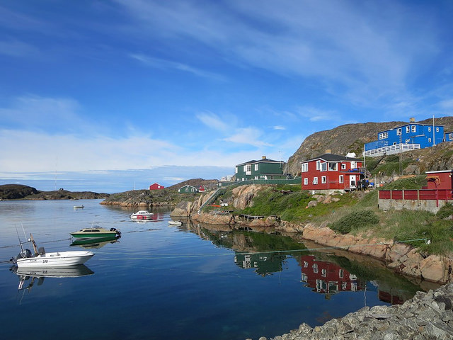Wooden homes line a scenic inlet at Sisimiut, Greenland. Photo: PRODavid Stanley. Flickr.